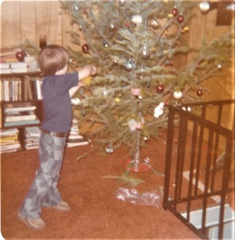 Decorating the tree. Check out those pants!