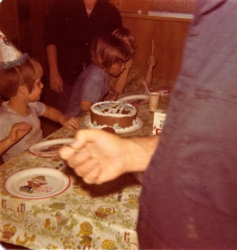 Birthday boy and cake! And who is that child next to me?